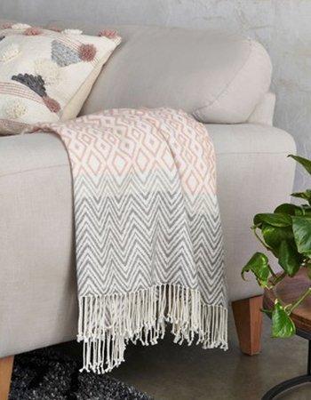 Pink woven throw, £25, Next