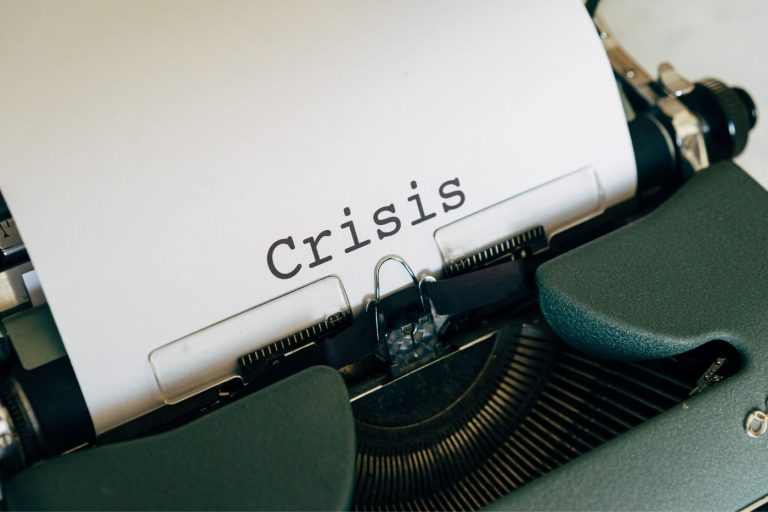 Typewriter with the words crisis on it