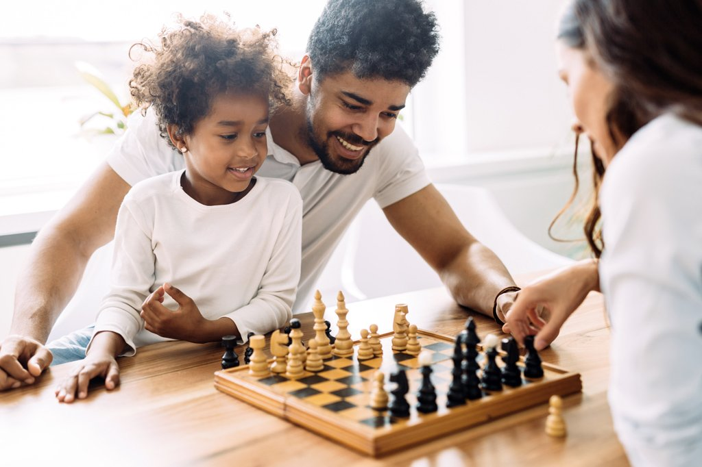 A family playing chess together