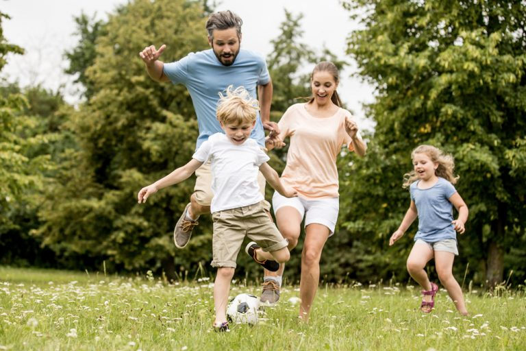 A family play football outside