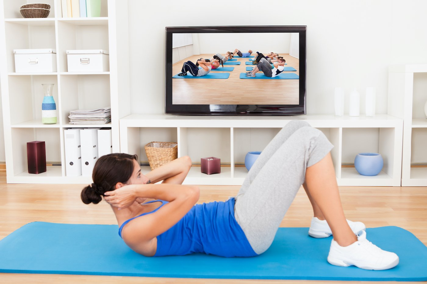 Woman in her lounge doing a video workout