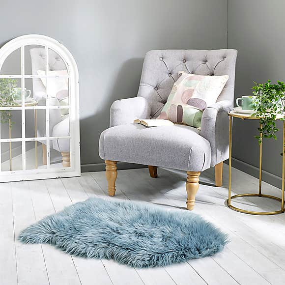 A sheepskin rug can add calm and cosiness to any room
