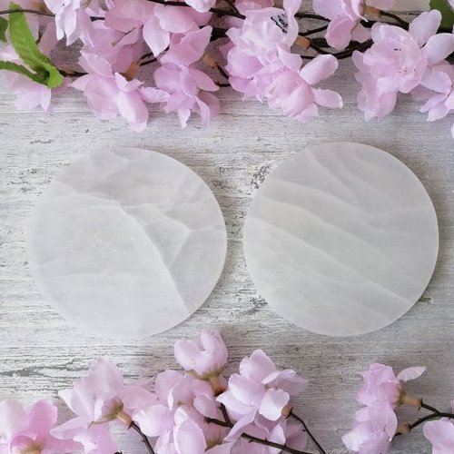 Selenite round slices help charge your crystals